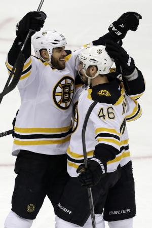 Boston Bruins' David Krejci (46) celebrates his goal with teammate Nathan Horton (18) in the first period of Game 1 of the NHL hockey Stanley Cup Eastern Conference finals against the Pittsburgh Penguins, Saturday, June 1, 2013, in Pittsburgh. (AP Photo/Gene J. Puskar)