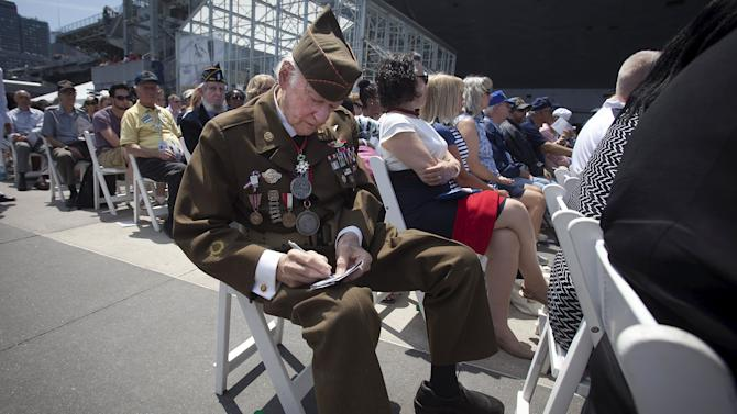 WWII Veteran and D-Day survivor Frederick Carrier takes notes during a Memorial Day ceremony at the Intrepid Sea, Air & Space Museum in the Manhattan borough New York