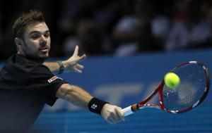 Wawrinka of Switzerland hits a return during his men's singles tennis match against Nadal of Spain at the ATP World Tour Finals at the O2 Arena in London