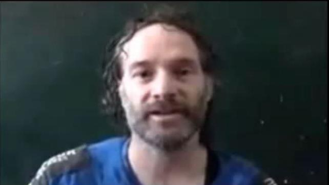 A screen grab from an Al-Jazeera video shows Peter Theo Curtis, a 45-year-old a freelance journalist, during his detention by Al-Qaeda militants in Syria