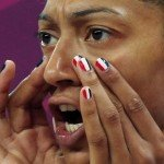 France's Emmeline Ndongue has her finger nails painted in the French flag colors as she yells from the bench during the women's preliminary round Group B basketball match against Australia at the Basketball Arena during the London 2012 Olympic Games
