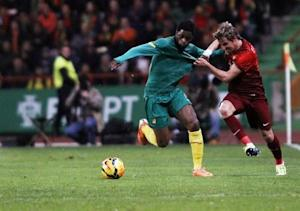 Portugal's Coentrao fights for the ball with the Cameroon's Alex Song during their international friendly soccer match at Leiria stadium