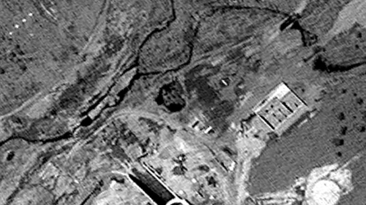 This April 29, 2012 satellite image provided by DigitalGlobe shows the Musudan-ri rocket launch site in northeastern North Korea. The U.S.-Korea Institute at Johns Hopkins School of Advanced International Studies says the image shows that North Korea is upgrading the launch site to handle bigger rockets, which could increase international concern over the secretive country's weapons programs. The black circle in the center of the image is a new launch pad. The rectangular buildings at center left and upper right are fuel storage facilities. (AP Photo/DigitalGlobe)