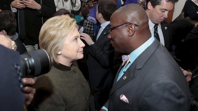 Democratic presidential candidate Hillary Clinton is greeted by local pastors at the House of Prayer Missionary Baptist Church after addressing the congregation about the Flint water crisis in Flint,