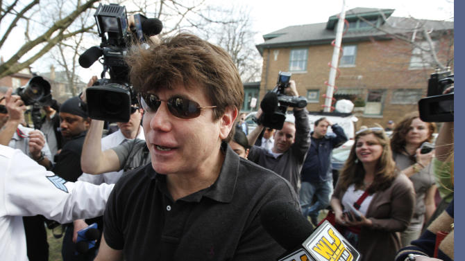 Former Illinois Gov. Rod Blagojevich is surrounded by journalists outside of his home Wednesday, March 14, 2012, in Chicago. Blagojevich was convicted of 18 criminal counts over two trials, including charges that accused him of attempting to sell or trade an appointment to President Barack Obama's vacated U.S. Senate seat. The 55-year-old Democrat is due to report to a prison in Colorado on Thursday to begin serving a 14-year sentence, making him the second Illinois governor in a row to go to prison for corruption. (AP Photo/Charles Rex Arbogast)