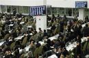 Diplomats watch electronic monitors showing a vote count, as the U.N. General Assembly voted and approved a draft resolution on the territorial integrity of the Ukraine at the U.N. headquarters in New York