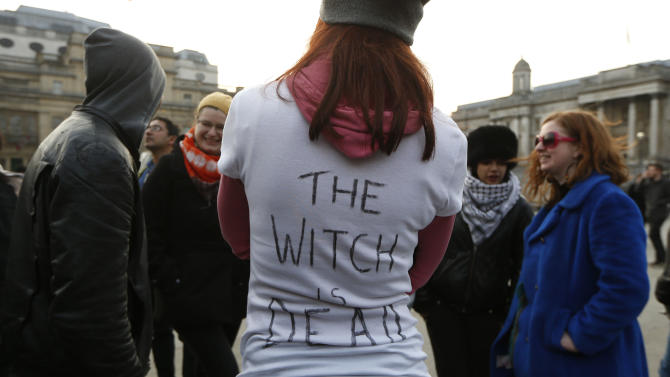 """Anti-Thatcher protesters react to the death of  former British Prime Minister as they gather at Trafalgar Square in London, Monday, April 8, 2013.  Opponents of the late Margaret Thatcher are taking a kind of musical revenge on the former prime minister, pushing the song """"Ding Dong! The Witch is Dead"""" up the British charts in a posthumous protest over her polarizing policies. By Friday, April 12, 2013,  the online campaign had propelled the """"Wizard of Oz"""" song to No. 1 on British iTunes and into the top five of the music chart used by the BBC to compile its weekly radio countdown. The unusual campaign has caused a headache for the BBC. With the ditty near the top of the charts, the broadcaster faced the prospect of airing the words """"The Wicked Witch is Dead!"""" on its Sunday countdown show, just days before Thatcher's funeral, scheduled for Wednesday.  (AP Photo/Sang Tan)"""