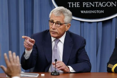 Defense Secretary Hagel and Joint Chiefs Chairman Gen. Dempsey hold a press briefing at the Pentagon