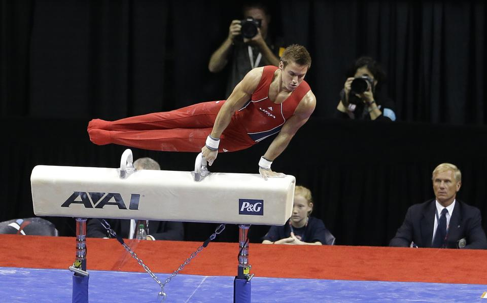 Sam Mikulak performs on the pommel horse during the final round of the men's Olympic gymnastics trials, Saturday, June 30, 2012, in San Jose, Calif. (AP Photo/Gregory Bull)