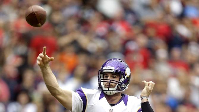 Minnesota Vikings quarterback Christian Ponder (7) throws a touchdown pass to Kyle Rudolph during the first quarter of an NFL football game  against the Houston Texans, Sunday, Dec. 23, 2012, in Houston. (AP Photo/Patric Schneider)