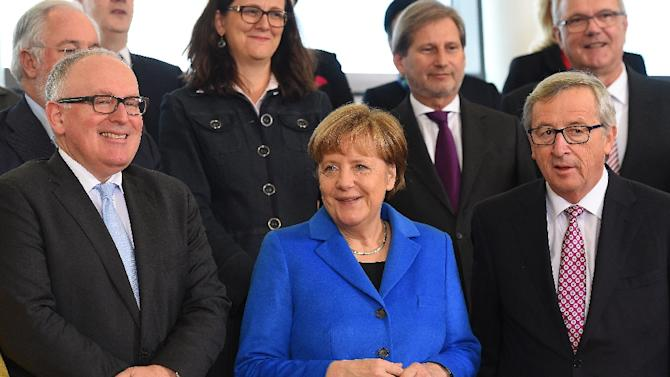 German Chancellor Angela Merkel (C)  with European Commission President Jean-Claude Juncker (R) and European Commission Vice-President Frans Timmermans in Brussels on March 4, 2015