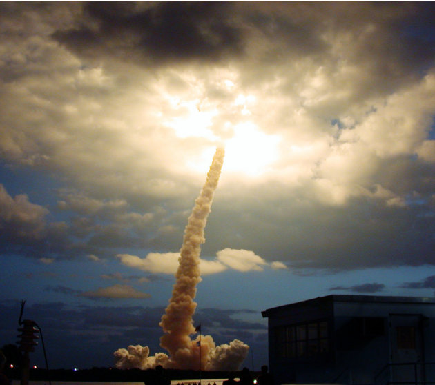 FILE - In this Friday, March 1, 2002 file picture, the space shuttle Columbia illuminates a cloud during its morning liftoff at the Kennedy Space Center in Cape Canaveral, Fla. (AP Photo/NASA, Anita B