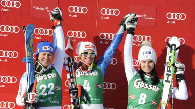 From left, Italy's Daniela Merighetti, second placed, Alice Mckennis of the United States, winner, and Anna Fenninger of Austria, third placed, celebrate on the podium of an alpine ski, women's World Cup downhill in St. Anton, Austria, Saturday, Jan.12, 2013. (AP Photo/Giovanni Auletta)