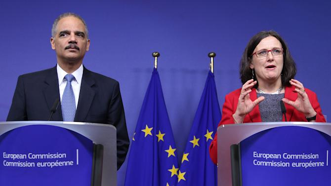 European Commissioner for Home Affairs Cecilia Malmstroem, right, and U.S. Attorney General Eric Holder, address the media on the launching conference of the Global Alliance against Child Abuse Online, at the European Commission headquarters in Brussels, Wednesday, Dec. 5, 2012. At the launching conference, 47 countries worldwide joined forces to fight child sexual abuse online. (AP Photo/Yves Logghe)