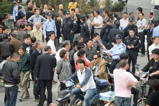&lt;p&gt;Residents are seen gathering outside the city government offices in Ningbo, in eastern China&#39;s Zhejiang province on October 29, as police and security personnel look on. Authorities in Ningbo said late Sunday that work on the 55.9-billion-yuan ($8.9 bln) oil refining and petrochemical complex would be called off after thousands of locals clashed with police in a week-long protest.&lt;/p&gt;