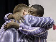 Comedian and actor Tracy Morgan hugs Kevin Rogers, left, in Nashville, Tenn., after Morgan apologized Tuesday, June 21, 2011, for anti-gay remarks he made during a performance in Nashville on June 3. Rogers attended the June 3 show and first reported the incident via Facebook. (AP Photo/Mark Humphrey)