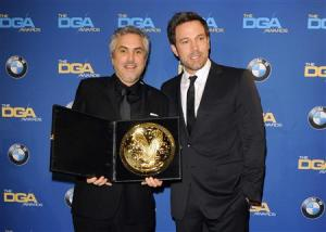 "Ben Affleck presents Mexican director Alfonso Cuaron with the Feature Film award for ""Gravity"" during the 66th annual Directors Guild of America Awards in Beverly Hills"