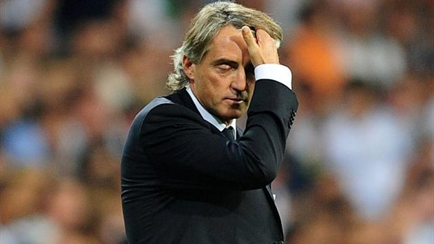 Manchester City's Manager Roberto Mancini stands dejected towards the end of the game UEFA Champions League - Group D - Real Madrid v Manchester City - Santiago Bernabeu