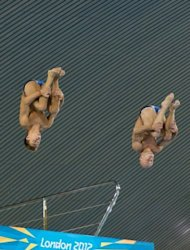 Britain's Tom Daley (left) and Peter Waterfield jump from the 10m board during a practice session ahead of the London 2012 Olympic Games at the Aquatics Centre in the Olympic Park in east London on July 16. Daley has been targeted by abusive Twitter messages after one of the Olympic hosts' poster boys missed out on a medal in his opening event at the London Games