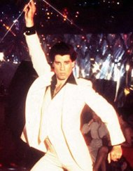 John Travolta dances his shirt off in