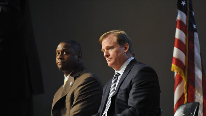NFL Commissioner Roger Goodell, right, and former NFL player Troy Vincent, Sr. listen as Congressman Elijah Cummings, D-MD, talks with students about the dangers of steroid use Monday, April 4, 2011 at Woodlawn High School in Woodlawn, Md.(AP Photo/Gail Burton)
