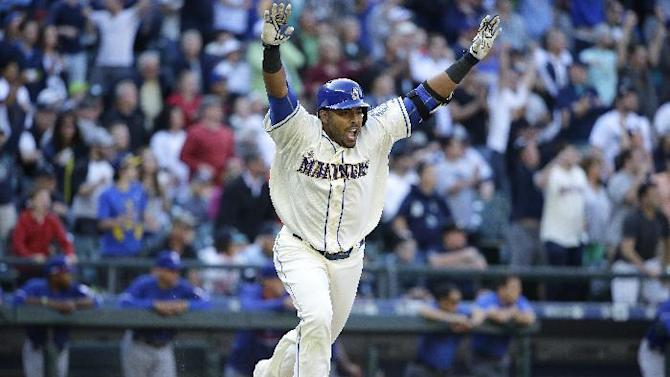 Seattle Mariners' Nelson Cruz celebrates after he hit a walk-off RBI single in the ninth inning of a baseball game to score Mariners' Seth Smith and give the Mariners a 11-10 win over the Texas Rangers,  Sunday, April 19, 2015, in Seattle. (AP Photo/Ted S. Warren)