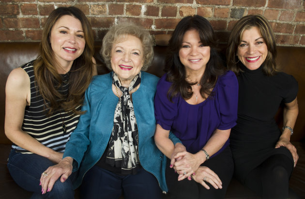 This Nov. 27, 2012 photo shows &quot;Hot in Cleveland&quot; co-stars, from left, Jane Leeves, Betty White, Valerie Bertinelli and Wendie Malick in New York. Their TV Land sitcom focuses on three slightly past their prime gal-pals from Los Angeles who decide to make a fresh start in Cleveland, where they rent a house whose caretaker, played by White, serves as their salty companion and foil. (Photo by Charles Sykes/Invision/AP)