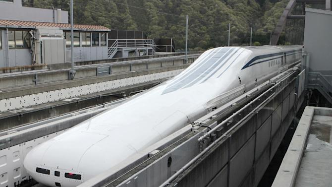 Central Japan Railway's maglev train returns to the station after setting a new world speed record in a test run near Mount Fuji, clocking more than 600 kilometres (373 miles) an hour on April 21, 2015