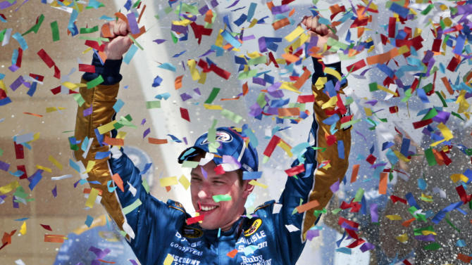 NASCAR driver Brad Keselowski celebrates in victory lane after winning a NASCAR Sprint Cup Series auto race at Kansas Speedway, Sunday, June 5, 2011, in Kansas City, Kan. (AP Photo/Orlin Wagner)