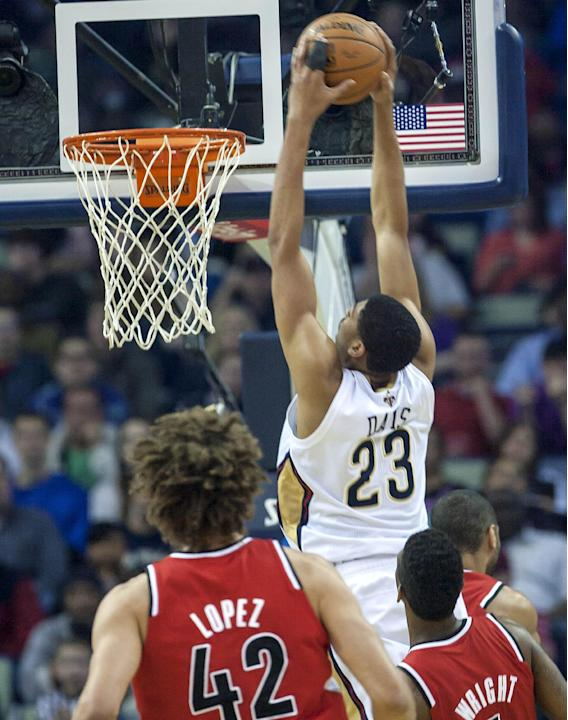 New Orleans Pelicans forward Anthony Davis (23) dunks against the Portland Trail Blazers in the first half of an NBA basketball game in New Orleans, Friday, March 14, 2014