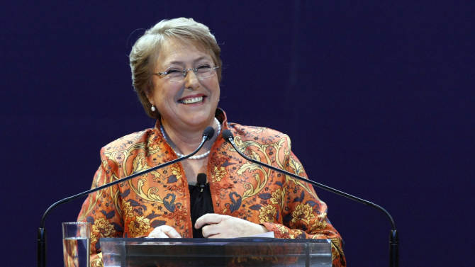 FILE - In this April 13, 2013 file photo, Chile's former President Michelle Bachelet smiles as she speaks to supporters after being officially named as candidate for the presidency by the Socialist Party and the Party for Democracy in Santiago, Chile.  Bachelet, who was president from 2006 to 2010, is reaching out to the now-legal Communist Party and other left-leaning groups in her bid to return to the nation's top post. (AP Photo/Luis Hidalgo, File)