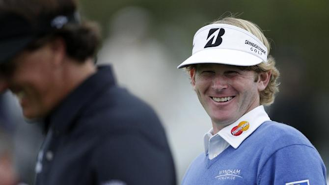 Brandt Snedeker, right, jokes with Phil Mickelson as they walk down the fourth fairway the north course at Torrey Pines Golf Course during the first round of the Farmers Insurance Open golf tournament Thursday, Jan. 24, 2013, in San Diego. (AP Photo/Gregory Bull)