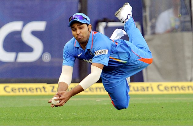 Indian fieldsman Rohit Sharma dives and