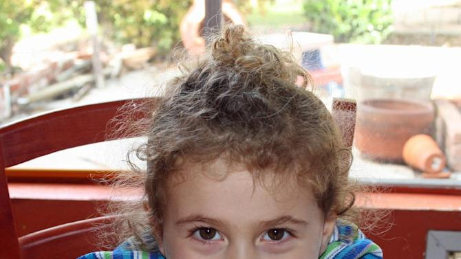"""AVIELLE RICHMAN, 6: The curly headed little girl known as Avie Richman loved a lot of things. Horses. Harry Potter. The color red. She tried archery after watching the Disney movie """"Brave."""" She told her parents that her dream car was a minivan. (AP Photo/Richman Family Photo)"""
