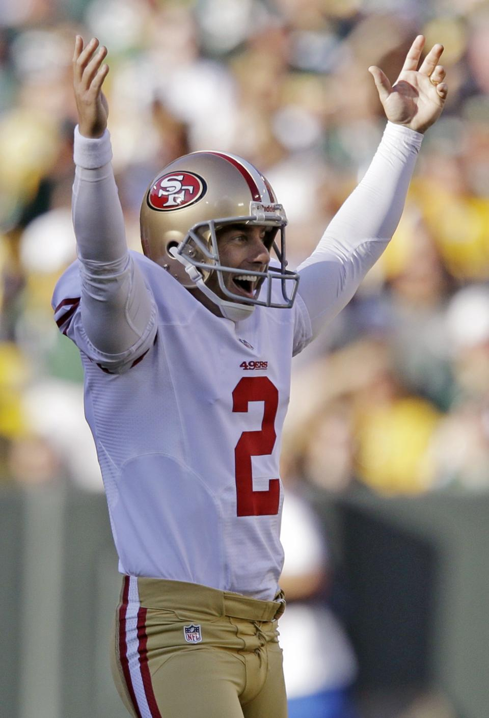 San Francisco 49ers kicker David Akers reacts after kicking a 63-yard field goal during the first half of an NFL football game against the Green Bay Packers Sunday, Sept. 9, 2012, in Green Bay, Wis. Akers tied an NFL record with the field goal. (AP Photo/Jeffrey Phelps)