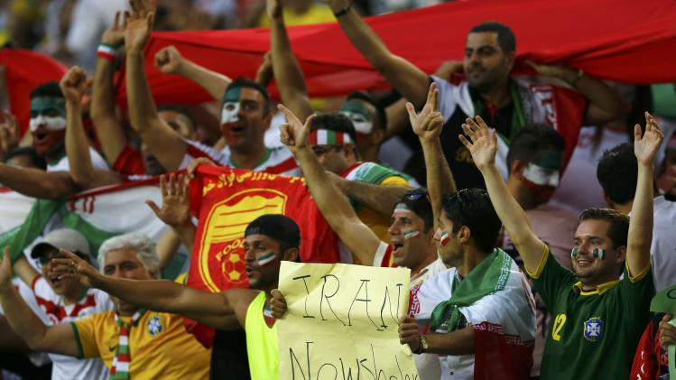 Iran fans cheer during the 2014 World Cup Group F soccer match between Iran and Nigeria at the Baixada arena