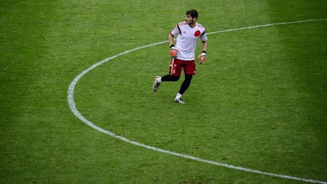 Spain's goalkeeper Iker Casillas attends a training session at the Atletico Paranaense training center in Curitiba, Brazil, Tuesday, June 10, 2014. Spain will play in group B of the Brazil 2014 World Cup. (AP Photo/Manu Fernandez)