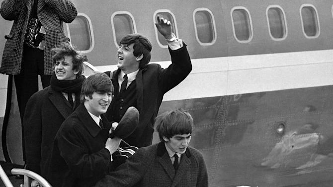 FILE - In this this Feb. 7, 1964 file photo, Britain's Beatles arrive at John F. Kennedy Airport, in New York, after their flight from London. From left to right, Ringo Starr, John Lennon, Paul McCartney and George Harrison. The Beatles would go on to take America by storm, and rock 'n' roll was never the same. (AP Photo/File)