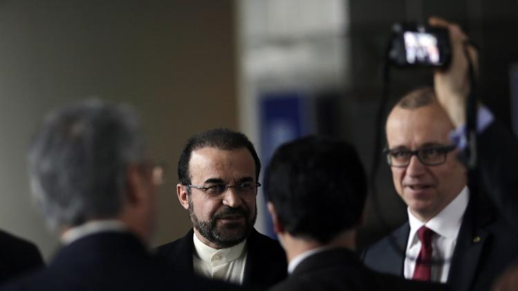 Iran's ambassador to the IAEA Najafi and IAEA Deputy Director General Varjoranta leave a news conference in Vienna