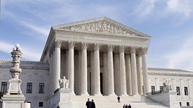 FILE - In this Jan. 25, 2012 file photo, the U.S. Supreme Court Building is seen in Washington. The health insurance industry is spending millions to carry out President Barack Obama's health care overhaul, essentially betting that the law or major parts of it will survive Supreme Court scrutiny.  (AP Photo/J. Scott Applewhite, File)