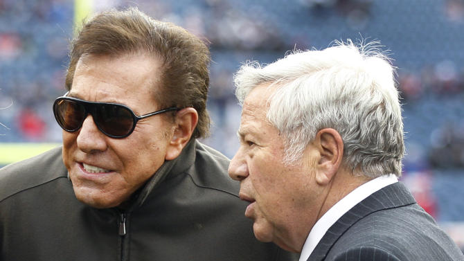 FILE- In this Sunday, Dec. 4, 2011, file photo,  New England Patriots owner Robert Kraft, right, talks with casino mogul Steve Wynn at Gillette Stadium prior to the Patriots' NFL football game against the Indianapolis Colts in Foxborough, Mass., Sunday, Dec. 4, 2011. Efforts to bring a $1 billion resort-style casino proposed by Wynn to the New England Patriots' hometown have been suspended after an announcement Tuesday, May, 8, 2012 by The Kraft Group and Wynn Resorts, a day after voters elected two selectmen who opposed opening negotiations with Wynn. (AP Photo/Elise Amendola)