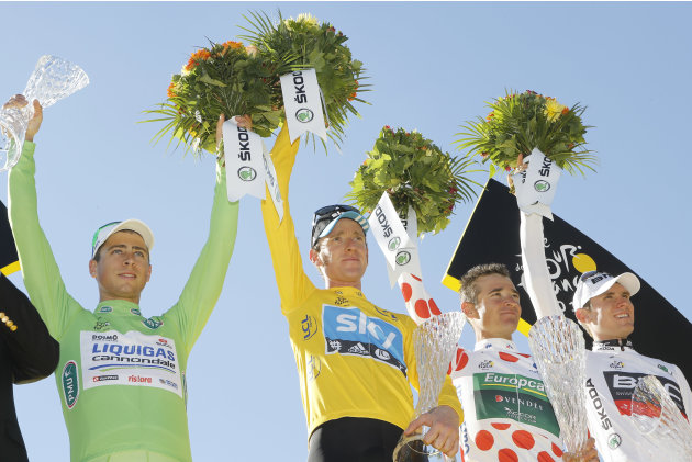 Tour de France winner Bradley Wiggins of Britain, second left, best climber Thomas Voeckler of France, second right, best sprinter Peter Sagan of Slovakia, left, and best young rider Tejay van Gardere