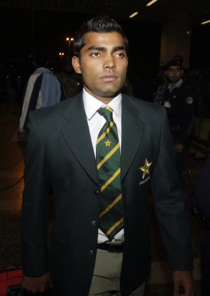 FILE - In this Thursday, Feb. 10, 2011 file photo, Pakistani cricketer Umar Akmal arrives at Allama Iqbal airport to leave for Bangladesh to participate in the upcoming World Cup, at Lahore, Pakistan. On Saturday, Feb. 1, 2014, police detained Pakistan cricketer Umar Akmal and charged him with slapping a traffic sergeant after violating a traffic signal in Lahore. (AP Photo/K.M.Chaudary, File)