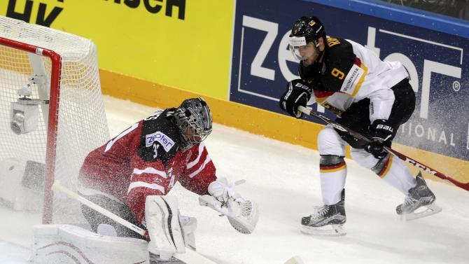 Germany's Rieder tries to score past Canada's goaltender Jones during their Ice Hockey World Championship game at the O2 arena in Prague