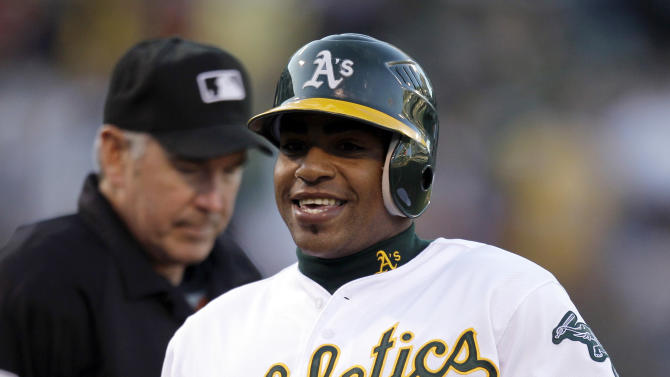 Oakland Athletics' Yoenis Cespedes runs the bases after hitting a two-run home run off New York Yankees' Freddy Garcia in the first inning of a baseball game, Thursday, July 19, 2012, in Oakland, Calif. (AP Photo/Ben Margot)