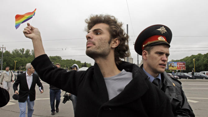 "FILE  - In this Saturday, May 16, 2009 file photo a gay rights activist is detained by a police officer  in Moscow, Russia. A controversial bill banning ""homosexual propaganda"" will be submitted to Russia's lower house of parliament for the first of three hearings Tuesday, Jan. 22. 2013.(AP Photo/Alexander Zemlianichenko, file)"