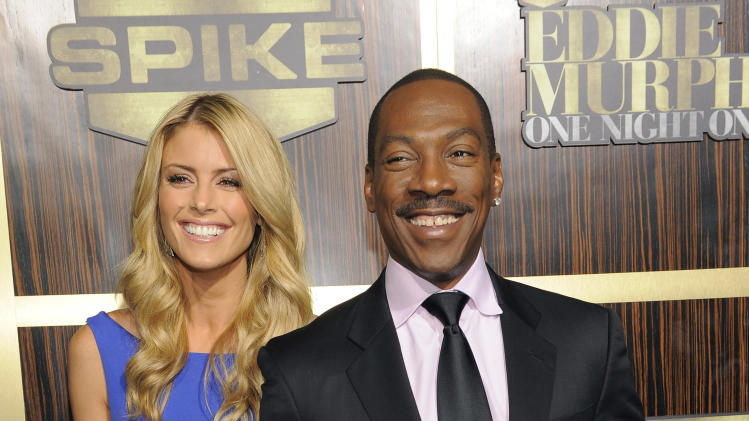 "Eddie Murphy arrives with his date Paige Butcher at ""Eddie Murphy: One Night Only,"" a celebration of Murphy's career at the Saban Theater on Saturday, Nov. 3, 2012, in Beverly Hills, Calif. (Photo by Chris Pizzello/Invision)"