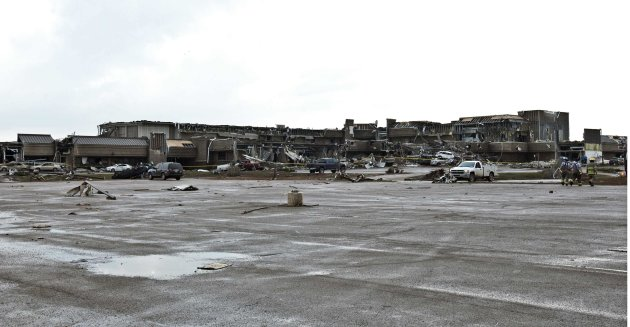 A shopping plaza lies in ruin after a huge tornado struck Moore, Oklahoma