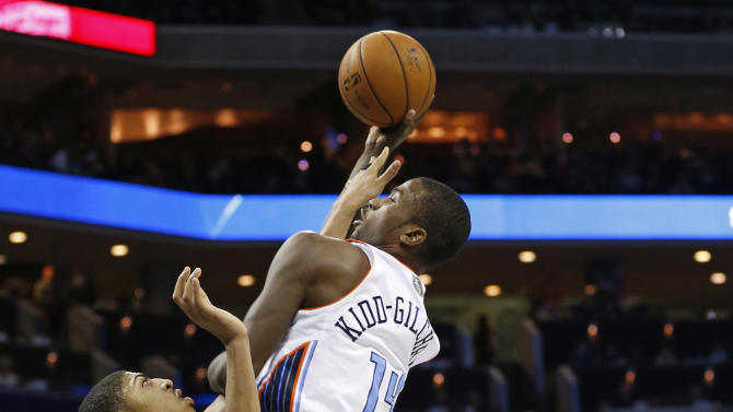 Charlotte Bobcats' Michael Kidd-Gilchrist (14) shoots over New Orleans Hornets' Anthony Davis (23) during the first half of an NBA basketball game in Charlotte, N.C., Saturday, Dec. 29, 2012. (AP Photo/Chuck Burton)