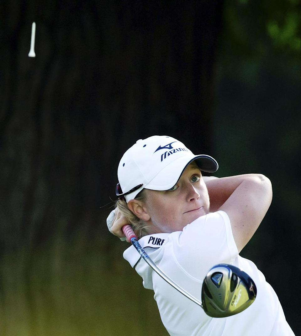 Stacy Lewis watches her tee shot on the first hole during the final round of the LPGA Tour's Canadian Women's Open golf tournament, Sunday, Aug. 26, 2012, at the Vancouver Golf Club in Coquitlam, British Columbia. (AP Photo/The Canadian Press, Darryl Dyck)